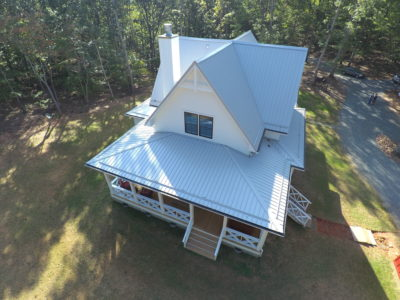 Home and porch are covered with metal roofing